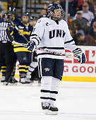 Damon Kipp (UNH - 4) - The Merrimack College Warriors defeated the University of New Hampshire Wildcats 4-1 (EN) in their Hockey East Semi-Final on Friday, March 18, 2011, at TD Garden in Boston, Massachusetts.