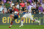FC Barcelona's Pedro Rodriguez (l) and Real Valladolid's Alberto Marcos during La Liga match.April 4 2009. (ALTERPHOTOS/Acero).