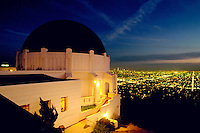 Griffith Park Observatory at night, with a view of the lights of Los Angeles below. Los Angeles, California.