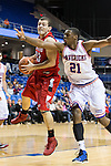 Seattle Redhawks guard Luiz Bidart (33) and Texas-Arlington Mavericks forward Greg Gainey (21) in action during the game between the Seattle Redhawks and the Texas Arlington Mavericks at the College Park Center arena in Arlington, Texas. Seattle defeats Arlington 61 to 44....