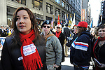 Captain Tracey Frink, 30, of Queens, New York, a Captain in the 203 Public Affairs Detachment with the 103rd ESC, center in uniform, is seen at the Veteran's Day Parade on Fifth Avenue with the organization American Women Veterans and Service Women's Action Network (SWAN) in New York, New York on November 11, 2010.  Frink, currently a reservist, joined the army in 1997 and was released in August from active duty in Afghanistan after four tours in Guantanamo Bay, Cuba, Kuwait and Afghanistan; she is currently looking forward to moving to Minnesota to attend design school.
