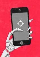 Skeleton hand holding smart phone waiting for loading symbol ExclusiveImage