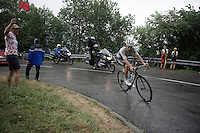 World Champion Michal Kwiatkowski (POL/Etixx-Quickstep) as race leader in the rain up the final climb of the day; the Plateau de Beille<br /> <br /> stage 12: Lannemezan - Plateau de Beille (195km)<br /> 2015 Tour de France