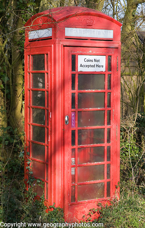 'Coins Not Accepted Here' sign on rural red telephone box, Suffolk, England
