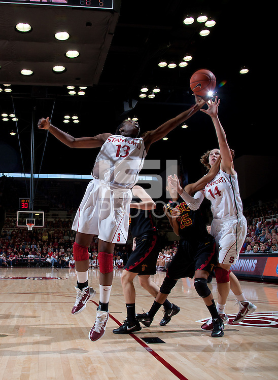 STANFORD, CA - January 22, 2011: Chiney Ogwumike of the Stanford women's basketball team pulls the ball in during Stanford's game against USC at Maples Pavilion. Stanford beat USC 95-51.