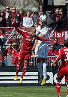 30 March 2013: Los Angeles Galaxy defender Omar Gonzalez #4 and Toronto FC forward Robert Earnshaw #10 in action during an MLS game between the LA Galaxy and Toronto FC at BMO Field in Toronto, Ontario Canada..The game ended in a 2-2 draw..