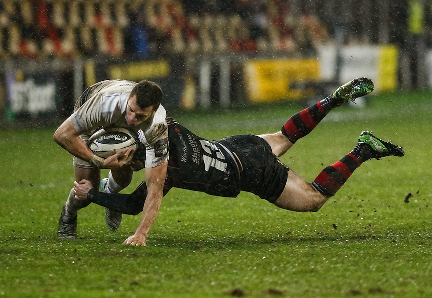 Leinster's Zane Kirchner is tackled by Newport Gwent Dragons' Adam Hughes<br /> <br /> Photographer Simon KIng/CameraSport<br /> <br /> Rugby Union - Guinness PRO12 Round 13 - Newport Gwent Dragons v Leinster - Friday 29th January 2016 - Rodney Parade - Newport<br /> <br /> &copy; CameraSport - 43 Linden Ave. Countesthorpe. Leicester. England. LE8 5PG - Tel: +44 (0) 116 277 4147 - admin@camerasport.com - www.camerasport.com
