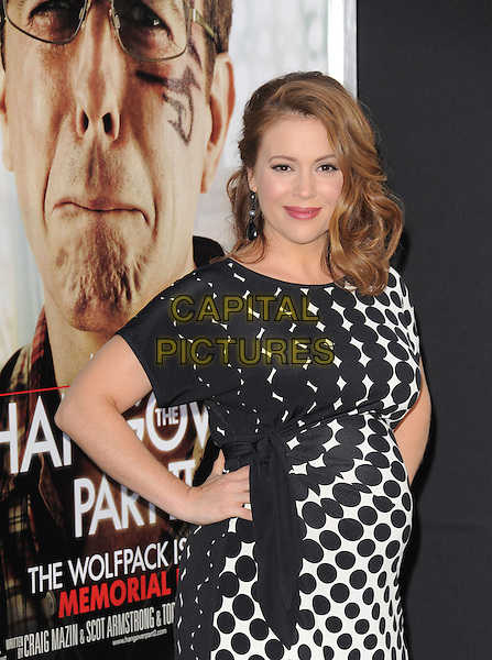 ALYSSA MILANO .at Warner Bros Pictures' L.A. Premiere of 'The Hangover Part 2' held at The Grauman's Chinese Theatre in Hollywood, California, USA, .May 19th 2011..half length black and white print dress pregnant hands on hips .CAP/RKE/DVS.©DVS/RockinExposures/Capital Pictures.