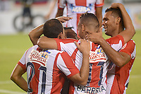 BARRANQUILLA - COLOMBIA - 12-08-2015.  Jarlan Barrera del Atletico Junior de Colombia celebra su gol con su companeros contra Melgar del Peru  durante partido  por la fecha 1 de la Copa Suramericana jugado en el estadio Metropolitano / Jarlan Barrera  player  of Atletico  Junior  celebrates his goal with his parnerts against  of Melgar of Peru  during a match for the firts  date of the Liga Aguila II 2015 played at Metropolitano  stadium in Barranquilla city. Photo: VizzorImage / Alfonso Cervantes  / Contibuidor