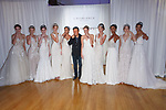 Kevin Lu, CEO & Founder poses with models at the close of the Casablanca Bridal 20th anniversary celebration runway show, on October 8, 2017; during New York Bridal Fashion Week Spring 2018.