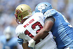 01 September 2012: UNC's Sylvester Williams (92) sacks Elon quarterback Thomas Wilson (12). The University of North Carolina Tar Heels played the Elon University Phoenix at Kenan Memorial Stadium in Chapel Hill, North Carolina in a 2012 NCAA Division I Football game. UNC won the game 62-0.