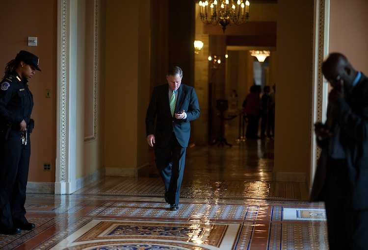 UNITED STATES - May 21: Sen. Richard Burr,R-NC., walks to the Senate luncheons in the U.S. Capitol through the Ohio Clock Corridor on May 20, 2013.  (Photo By Douglas Graham/CQ Roll Call)