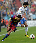 Real Zaragoza's Angel Lafita (r) and FC Barcelona's Sergio Busquets  during La Liga match.October 23,2010. (ALTERPHOTOS/Acero)