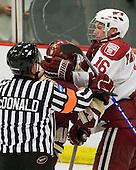 Cam Atkinson (BC - 13), Alex Fallstrom (Harvard - 16) - The Boston College Eagles defeated the Harvard University Crimson 3-2 on Wednesday, December 9, 2009, at Bright Hockey Center in Cambridge, Massachusetts.