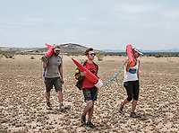 From left, Michael Zody, Andy Zacek, and  Amanda Johnson retrieve their rocket after a launch at the Spaceport America Cup near the town of Truth or Consequences, New Mexico, Friday, June 23, 2017. The International Intercollegiate Rocket Engineering Competition hosted over 110 teams from colleges and universities in eleven countries. Students launched solid, liquid, and hybrid rockets to target altitudes of 10,000 and 30,000 feet. The 2017 Spaceport America Cup winner was the University of Michigan, Ann Arbor, Team 79.<br /> <br /> Photo by Matt Nager