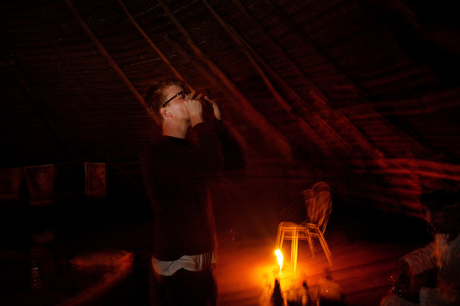 Iquitos, Peru, September 13, 2013 - Writer Alard Kittlitz drinking the ayahuasca.