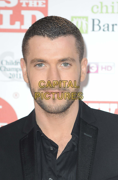 SHAYNE WARD .arriving at the News Of The World Children's Champion Awards 2011 at the Grosvenor House Hotel, London, England, UK, 30th March 2011..portrait headshot black shirt beard facial hair .CAP/WIZ.© Wizard/Capital Pictures.