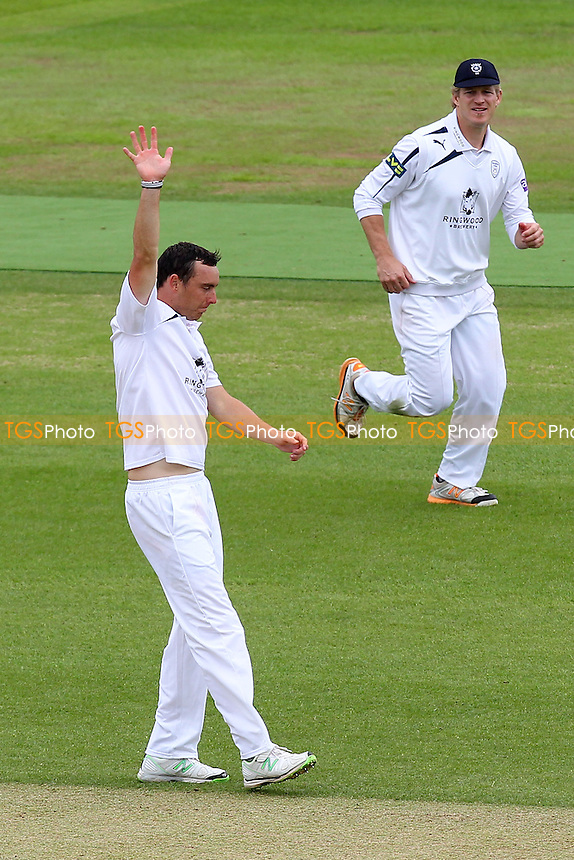 Kyle Abbott of Hampshire celebrates the wicket of Reece Topley - Hampshire CCC vs Essex CCC - LV County Championship Division Two Cricket at the Ageas Bowl, West End, Southampton - 16/06/14 - MANDATORY CREDIT: Gavin Ellis/TGSPHOTO - Self billing applies where appropriate - 0845 094 6026 - contact@tgsphoto.co.uk - NO UNPAID USE
