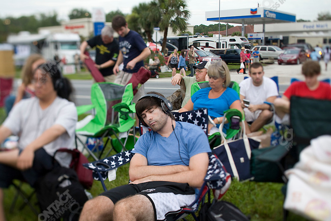 Crowds gather to watch the launch of Space Shuttle Atlantis from the Kennedy Space Center, Cape Canaveral.  It is the final mission of the Space Shuttle program which NASA is ending after thirty years. Titusville, Florida, July 8, 2011