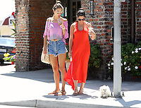 May 13 2014 Los Angeles California  Alessandra Ambrosio taking a stroll with her dog while enjoying an ice coffee on a sunny day in Los Angeles.  SP1/Starlitepics /NortePhoto