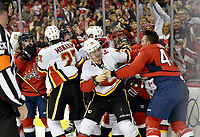 WASHINGTON, DC - FEBRUARY 01: Flames left wing Matthew Tkachuk (19) fights Capitals defenseman Brooks Orpik (44) as Capitals right wing T.J. Oshie (77) and right wing Tom Wilson (43) engage with Flames center Sean Monahan (23) and Flames defenseman Mark Giordano (5) at the end of the game during the Calgary Flames vs. the Washington Capitals NHL game on February 1, 2019 at Capital One Arena in Washington, D.C..