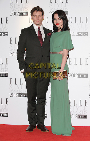 Sam Claflin & Laura Haddock.The ELLE Style Awards 2012, Savoy Hotel, London, England,.13th February 2012.full length green dress belt brown side coupe suit black clutch bag.CAP/BEL.©Tom Belcher/Capital Pictures.