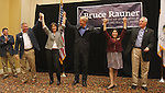 Illinois Republican gubernatorial candidate Bruce Rauner stopped at the Regency Conference Center in O'Fallon as part of his bus trip around the state on Wednesday. With him at the appearance (from left): Illinois Senator Kyle McCarter (applauding), U.S. congressional candidate Mike Bost, Rauner's wife Diana, Rauner, Lt. Governor candidate Evelyn Sanguinetti, and U.S. Congressman John Shimkus.