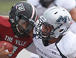 Lindenwood University - Belleville QB Anthony Dorsey (7, left) collides with a Menlo College player as Dorsey is sacked late in the first half of their Homecoming Game against the Oaks.