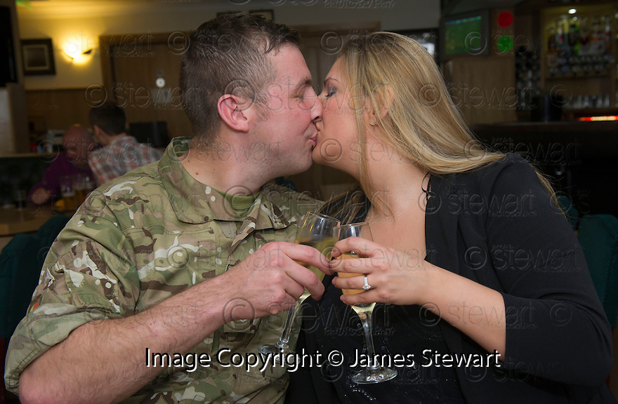"Jenna Stewart  and her boyfriend Paul ""Manny"" Davies enjoy a glass of champagne at a local bar after she accepted his wedding proposal displayed on a giant billboard poster in High Street, Kirkcaldy."