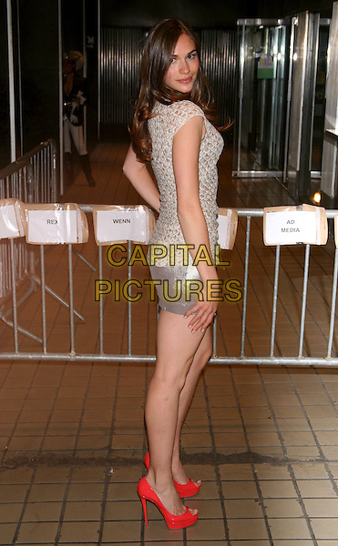 "JENNIFER MISSONI.The Premiere of ""Solitary Man"" at Cinema 2, New York, NY, USA..May 11th, 2010.full length hand on hip silver metallic mini skirt top pattern side shoes peep toe red gold.CAP/LNC/TOM.©TOM/LNC/Capital Pictures."