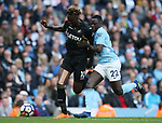 Benjamin Mendy of Manchester City tackles Tammy Abraham of Swansea City during the premier league match at the Etihad Stadium, Manchester. Picture date 22nd April 2018. Picture credit should read: Simon Bellis/Sportimage