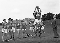 Dr Eamonn O'Sullivan, the famed Kerry trainer teaching his players how to field the ball during a training session in Fitzgerald Stadium, Killarney in 1955..Picture by Harry MacMonagle..© macmonagle.com photo archive