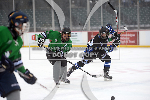 Notre Dame Fighting Irish of Batavia forward Zach Laird (12) races for the puck ahead of Alex Harley (22) during a varsity ice hockey game against the Brockport Blue Devils during the Section V Rivalry portion of the Frozen Frontier outdoor hockey event at Frontier Field on December 22, 2013 in Rochester, New York.  (Copyright Mike Janes Photography)