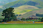 El Rincon Adobe and green hills in Spring at Talley Vineyards, Edna Valley, San Luis Obispo County, California