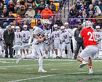University at Albany Men's Lacrosse defeats Cornell 11-9 on Mar 4 at Casey Stadium.  Jack Burgmaster (#23) shoots past Ryan Bray (#20).
