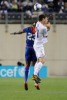 Brad Evans (21) of the United States (USA) and Abel Thermeus (23) of Haiti (HAI) go for a header. The United States and Haiti played to a 2-2 tie during a CONCACAF Gold Cup Group B group stage match at Gillette Stadium in Foxborough, MA, on July 11, 2009. .
