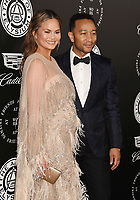 SANTA MONICA, CA - JANUARY 06: Model Chrissy Teigen (L) and singer-songwriter-actor John Legend arrive at the The Art Of Elysium's 11th Annual Celebration - Heaven at Barker Hangar on January 6, 2018 in Santa Monica, California.<br /> CAP/ROT/TM<br /> &copy;TM/ROT/Capital Pictures