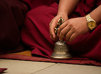 Buddhist Monk playing musical bell in a Losar ceremony, Sikkim, India