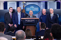 Director of the National Institute of Allergy and Infectious Diseases at the National Institutes of Health Dr. Anthony Fauci, center, joined by United States President Donald J. Trump and members of the Coronavirus Task Force, makes remarks on the Coronavirus crisis in the Brady Press Briefing Room of the White House in Washington, DC on Saturday, March 21, 2020. Credit: Stefani Reynolds / Pool via CNP/AdMedia