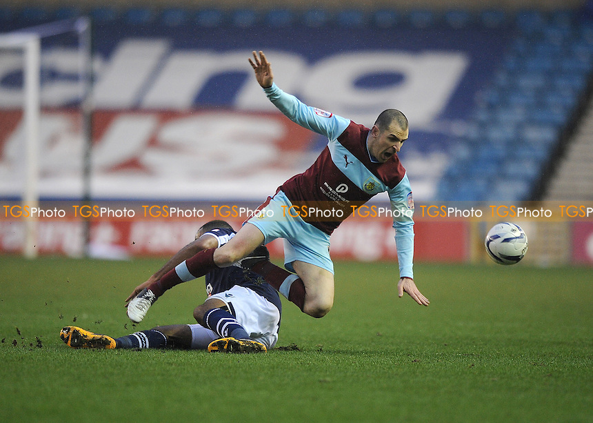 Liam Trotter of Millwall and Dean Marney of Burnley - Millwall vs Burnley - NPower Championship Football at the New Den - 19/01/2013 - MANDATORY CREDIT: Martin Dalton/TGSPHOTO - Self billing applies where appropriate - 0845 094 6026 - contact@tgsphoto.co.uk - NO UNPAID USE.