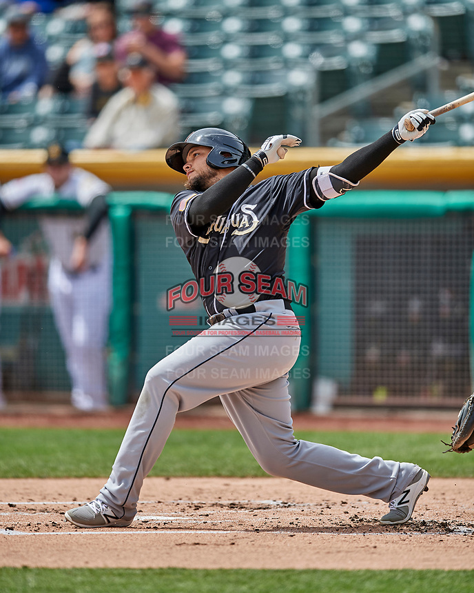 Diego Goris (8) of the El Paso Chihuahuas follows through on his swing against the Salt Lake Bees in Pacific Coast League action at Smith's Ballpark on April 30, 2017 in Salt Lake City, Utah. El Paso defeated Salt Lake 3-0. This was Game 1 of a double-header. (Stephen Smith/Four Seam Images)
