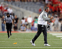 Ohio State Buckeyes head coach Urban Meyer yells at his team after a false start penalty during the second quarter of Saturday's NCAA Division I football game at Ohio Stadium in Columbus on September 27, 2014. (Columbus Dispatch photo by Jonathan Quilter)