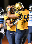 Althoff wide receiver Jordan Warner (left) is congratulated by teammate Mack Harris after Warner ran in a touchdown. Mater Dei played football at Althoff on Friday September 13, 2019. <br /> Tim Vizer/Special to STLhighschoolsports.com