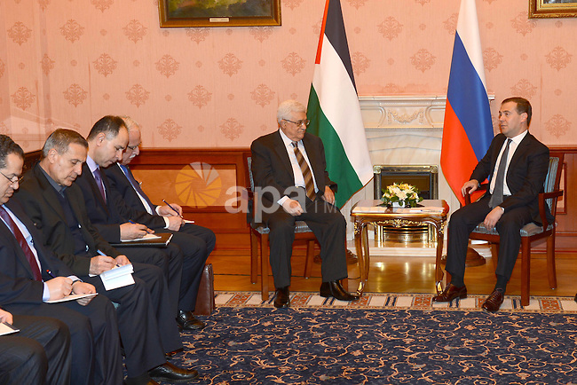 Palestinian President Mahmoud Abbas meets with Russian Prime Minister Dmitry Medvedev, at the Reception House of the Government of the Russian Federation, in Moscow on March 14, 2013. Photo by Thaer Ganaim
