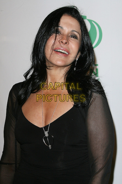 Maria Conchita Alonso.Global Green USA's 9th Annual Pre-Oscar Party held at the Avalon, Hollywood, California, USA..February 22nd, 2012.half length black dress sheer sleeves  .CAP/ADM.©AdMedia/Capital Pictures.