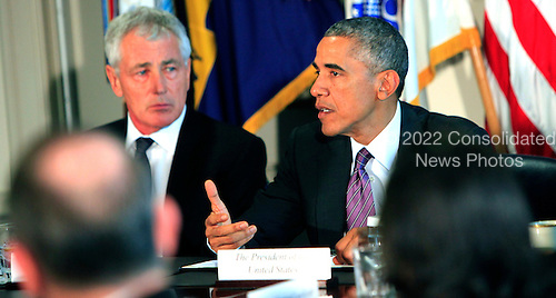 United States President Barack Obama meets with Senior Military Leadership at the Pentagon in Washington, D.C. on October 6, 2014. From left to right: U.S. Secretary of Defense Chuck Hagel, and President Obama. <br /> Credit: Dennis Brack / Pool via CNP