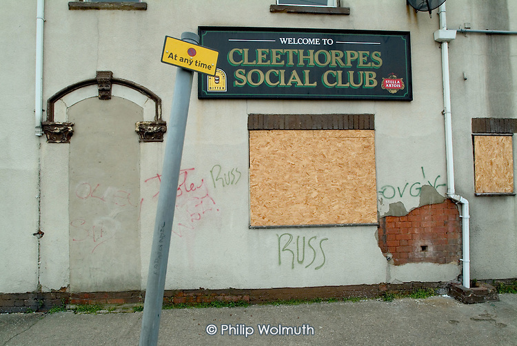 Boarded up windows of the Cleethorpes Social Club on the outskirts of the declining fishing port of Grimsby