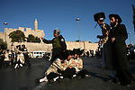 Ultra Orthodox Jews clash with Israeli police forces during weekly demonstrations against the Jerusalem's municipality's decision to open one of the parking lots in the city on Sabbath, Jerusalem, July 11, 2009. This is the third week in a row in which the Ultra-Orthodox Jews of Jerusalem have flocked in their thousands to the streets and continue clashes with police and members of the press. Photo By : Maya Levin / JINI