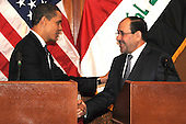 Baghdad, Iraq - April 7, 2009 -- United States President Barack Obama shakes hands with Prime Minister Nouri al-Maliki of Iraq after a joint press event on Camp Victory, Iraq, Tuesday, April 7, 2009..Credit: Kimberly Millett - DoD via CNP