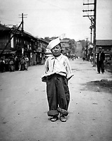 """A Korean orphan boy adopted by a motor pool battalion at Inchon, Korea and nursed back to health.  He is called """"Number One"""" by the boys of the motor pool.  June 6, 1951. (Navy)<br /> NARA FILE #:  080-G-429675<br /> WAR & CONFLICT BOOK #:  1484"""